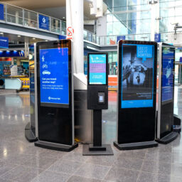Charity donations made easy with tap and go kiosks at UK railway stations.